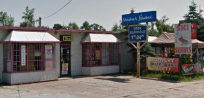 Znany z początku lat '90 szyld Michel Badre wciąż (2014) patronuje sklepowi w Zalesiu przy szosie z Piaseczna do Grójca. Fot. Google Street View
